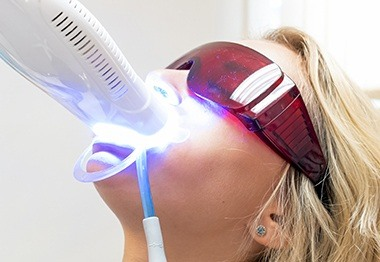 Patient receiving in office teeth whitening treatment
