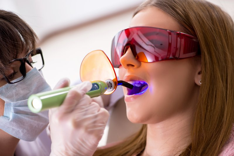 Dentist in Hoboken providing patient with filling