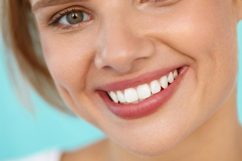 closeup of woman smiling after cosmetic dentistry